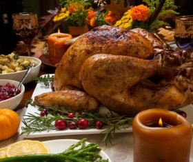 Grilled turkey and candles on the Thanksgiving table Stock Photo