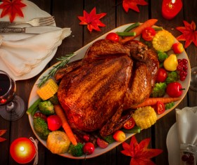 Grilled turkey and tableware on the Thanksgiving table Stock Photo