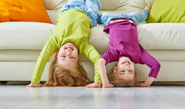 Happy child standing upside down HD picture free download