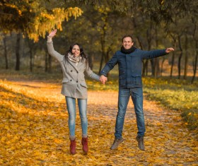Happy jumping husband and wife HD picture