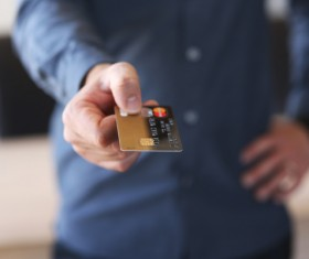 Holding a credit card Stock Photo