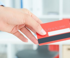 Holding a red credit card Stock Photo