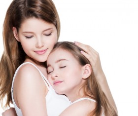 Hugging her daughter beautiful young mother Stock Photo