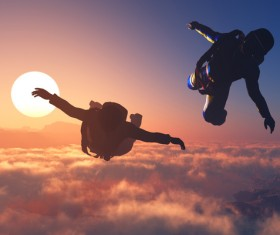 Limit skydiving with the fiery red sun Stock Photo