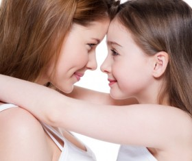 Mother and daughter embraced smiling Stock Photo