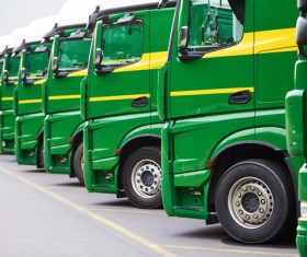 Neatly arranged delivery trucks HD picture