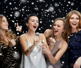 New Year Karaoke singing women Stock Photo