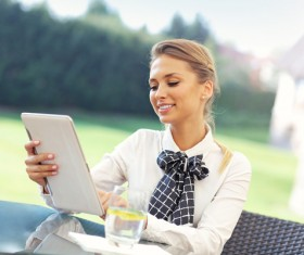 Outdoor resting woman using tablet HD picture