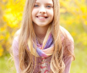 Pretty blonde little girl with autumn background
