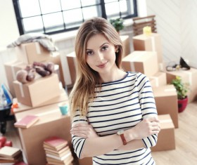 Pretty woman with boxes behind Stock Photo