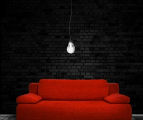 Red sofa chandelier with black brick wall