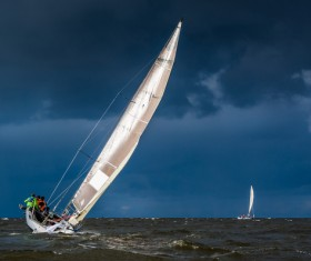 Severe weather sailing in the sea Stock Photo