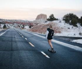 Shannon Kelley-Skateboarding girl road