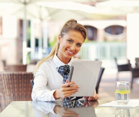 Smiling beautiful woman using a tablet PC HD picture