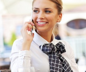 Smiling woman talking on the phone with desktop lemonade