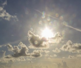 Sun and floating white clouds Stock Photo 02