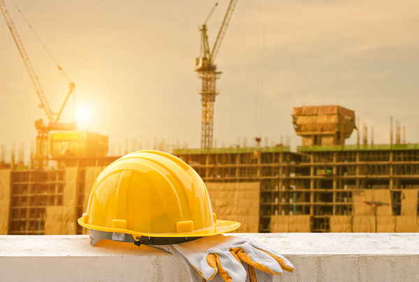 Sunset under construction with protective helmet