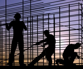 Sunset under the construction worker Stock Photo