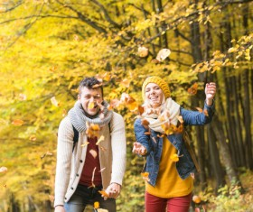 Sweet young couple throwing fallen leaves HD picture