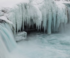The thick icicles on the river Stock Photo