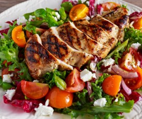 The vegetables are decorated with delicious grilled chicken