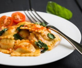 Tomatoes decorated with Italian dumplings HD picture