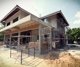 Unfinished villas with construction workers Stock Photo
