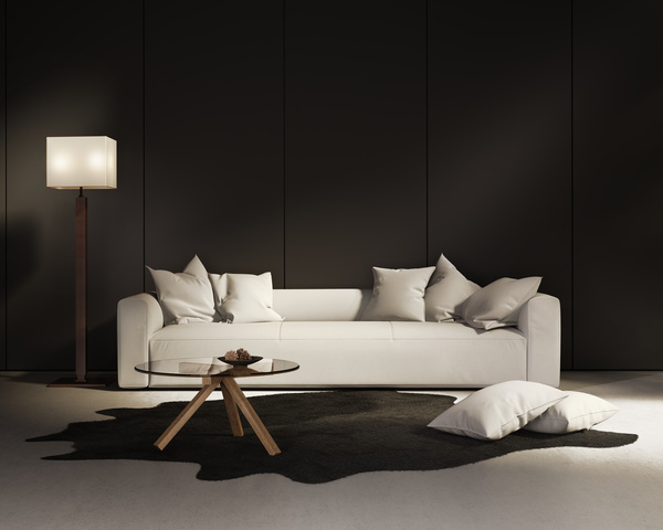 White Sofa With Black Wall Background Stock Photo