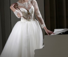 White wedding young bride with charming piano Stock Photo