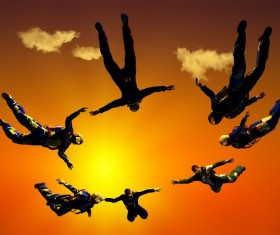 Yellow sun with skydiving athlete Stock Photo