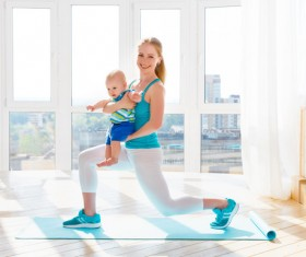 Young mother with baby fitness Stock Photo