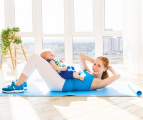 Young woman doing yoga fitness and baby Stock Photo 01