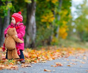 A little girl with a bear Stock Photo