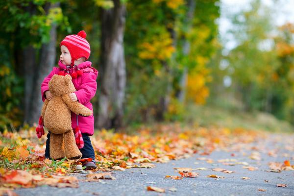 A little girl with a bear Stock Photo