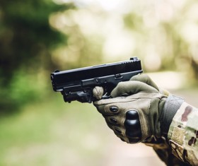 A soldier holding a pistol Stock Photo