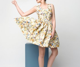 Beautiful young woman in nice dress Stock Photo