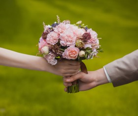 Bride and groom with bouquet Stock Photo