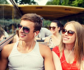 Couple listening to music on the bus Stock Photo