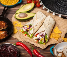 Delicious Mexican burrito with condiments Stock Photo
