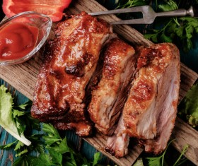 Delicious grilled pork ribs with vegetable sauce HD picture
