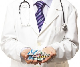 Doctor holding pill HD picture