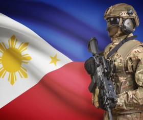 Filipino flag with heavily armed soldiers Stock Photo