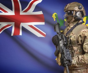 Flag of Fiji with heavily armed soldiers Stock Photo