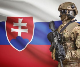 Flag of Slovakia with fully armed soldiers Stock Photo