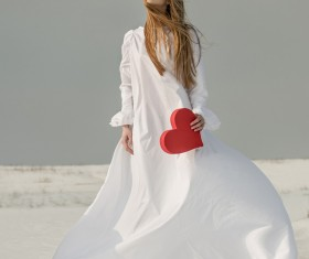 Heart-shaped girl in hand Stock Photo