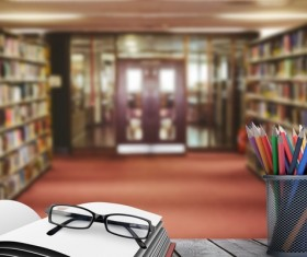 Library with desk pencil case with glasses Stock Photo 01