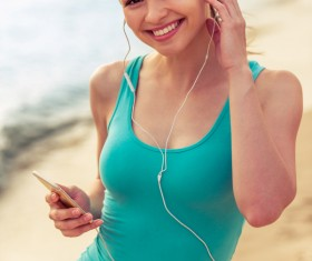 Listening to music Smiling woman Stock Photo