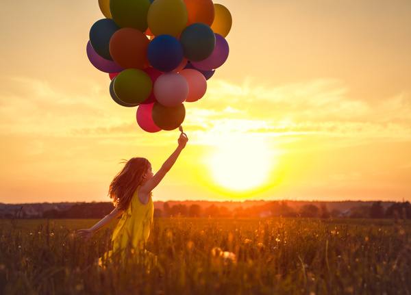 Little girl with balloon dawn Stock Photo