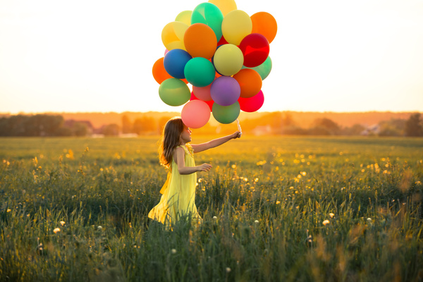 Little girl with balloons Stock Photo