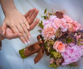 Newly married couple hand bouquet Stock Photo